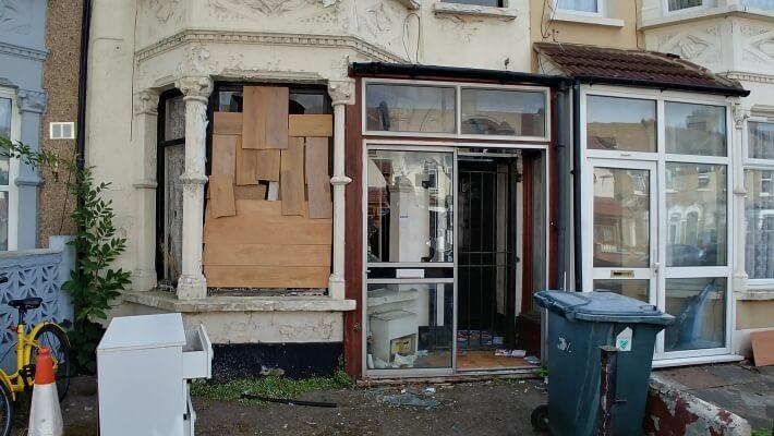 Derelict house with broken window